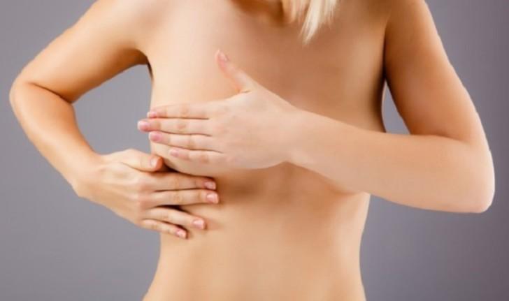 Чувствительная грудь в середине цикла